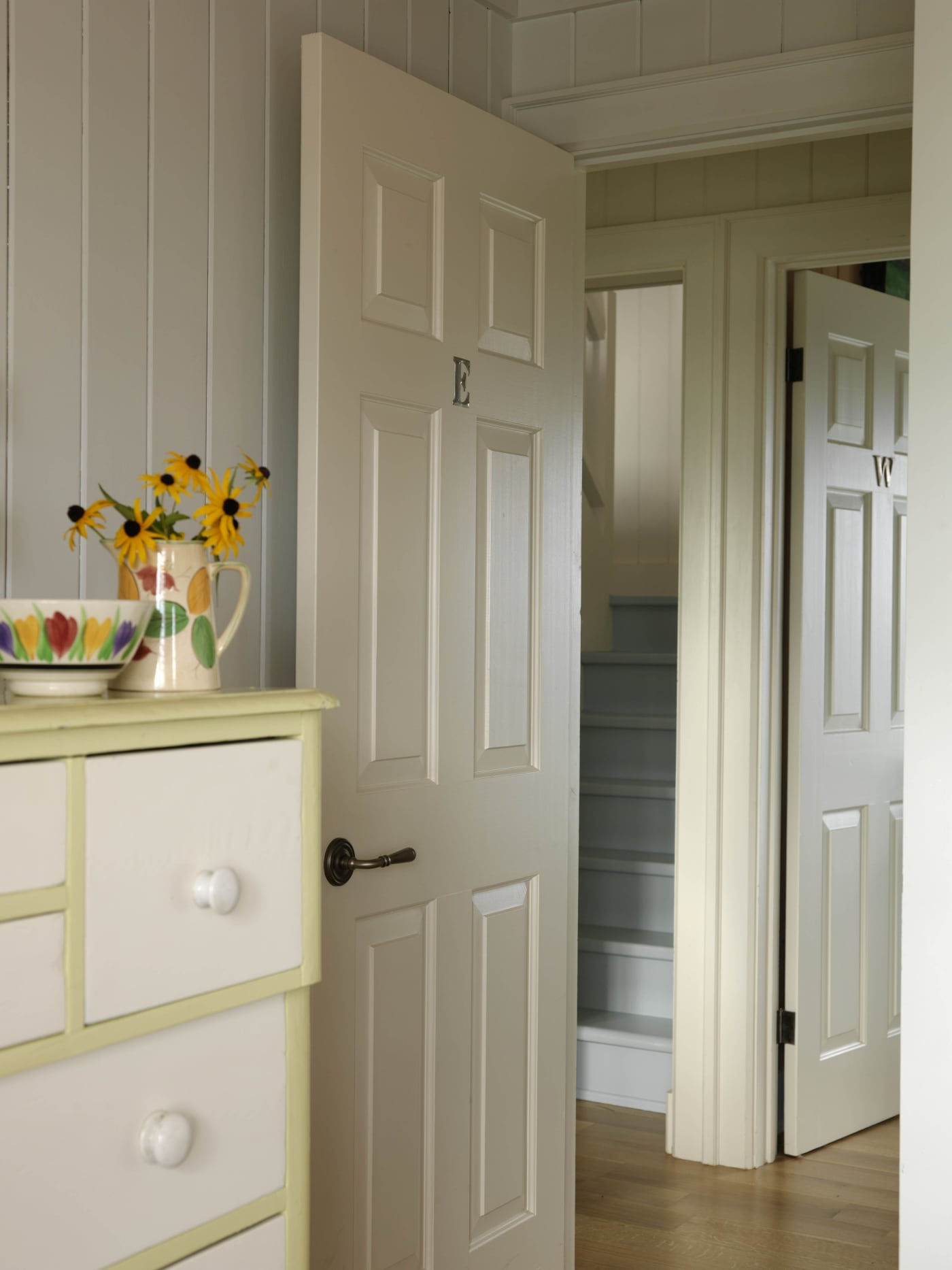 White and yellow dresser with mirror and decorations on it. #SarahRichardson #cottagestyle