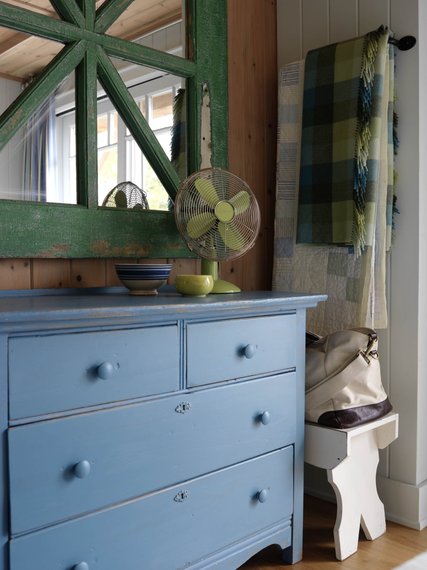 Bright blue dresser with green ornate mirror above. #SarahRichardson #cottagestyle