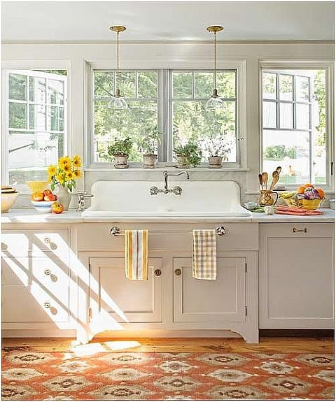 #SarahRichardson #cottagestyle Sunny yellow and white country kitchen with country farmhouse sink and Shaker cabinets