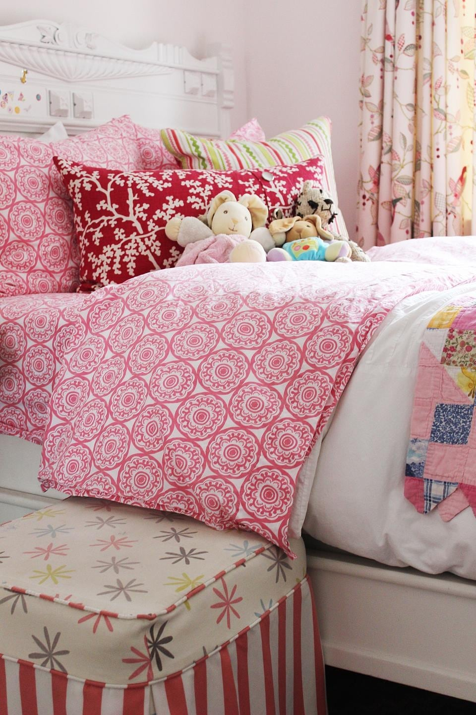 Sophie's Bed with patterned pink comforter and Pillows