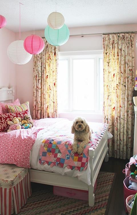 Pink girl's bedroom with patchwork quilt and Chinese lanterns - Sarah Richardson