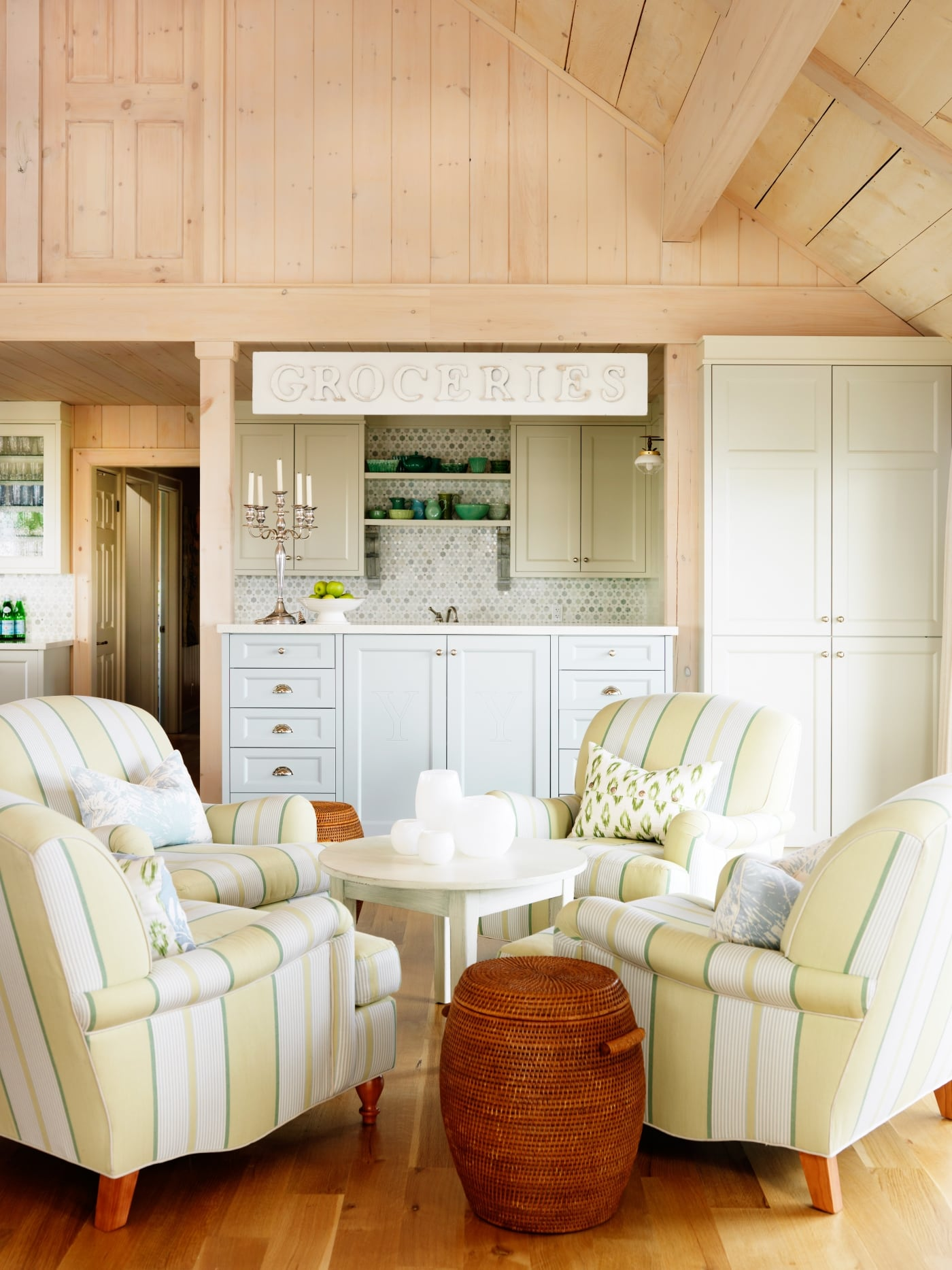 Groceries sign and 4 club chairs conversation area in woodsy cottage #SarahRichardson #cottagestyle