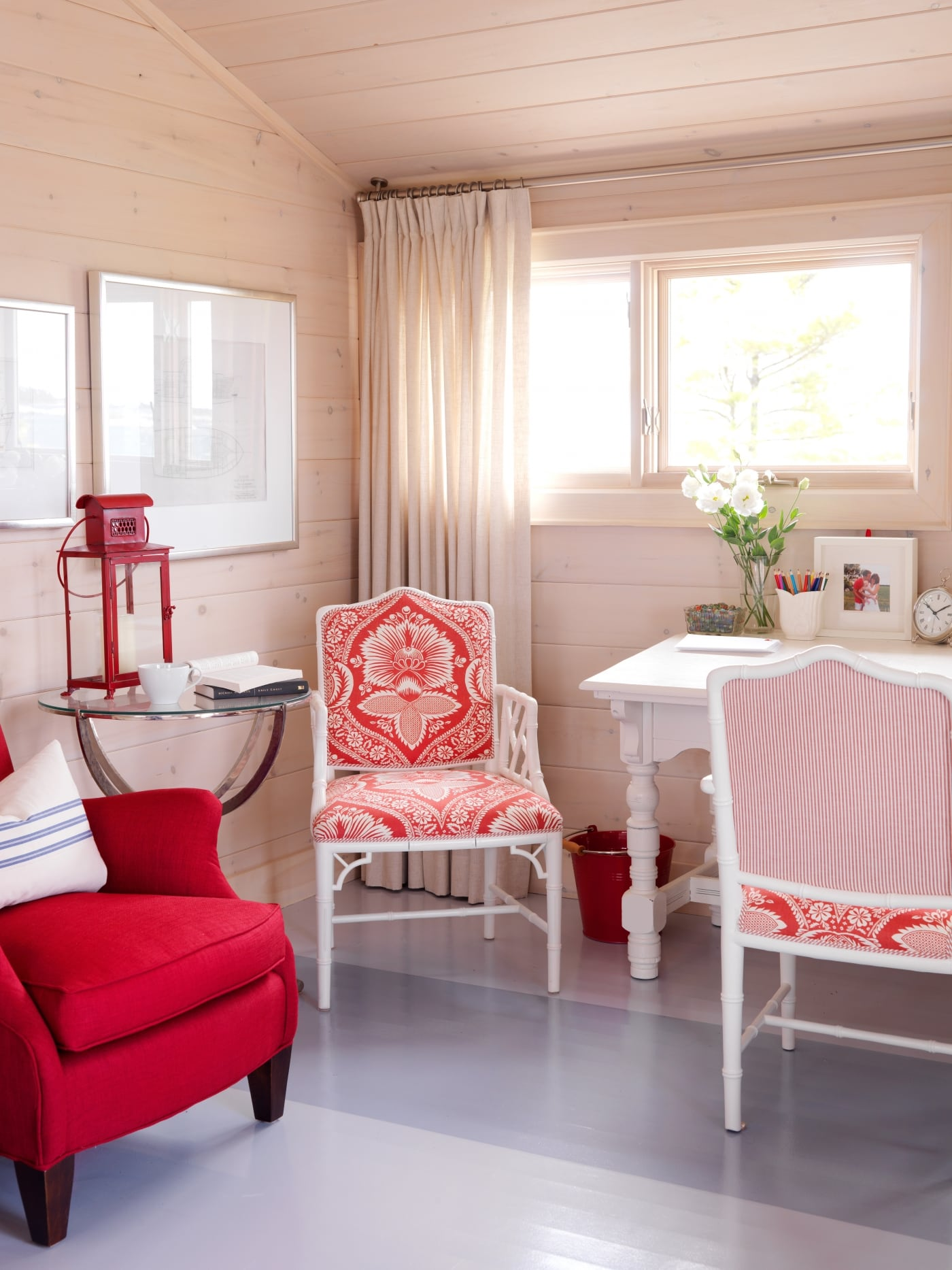 Whitewashed knotty pine paneling and painted stripes on floor in bedroom with pink