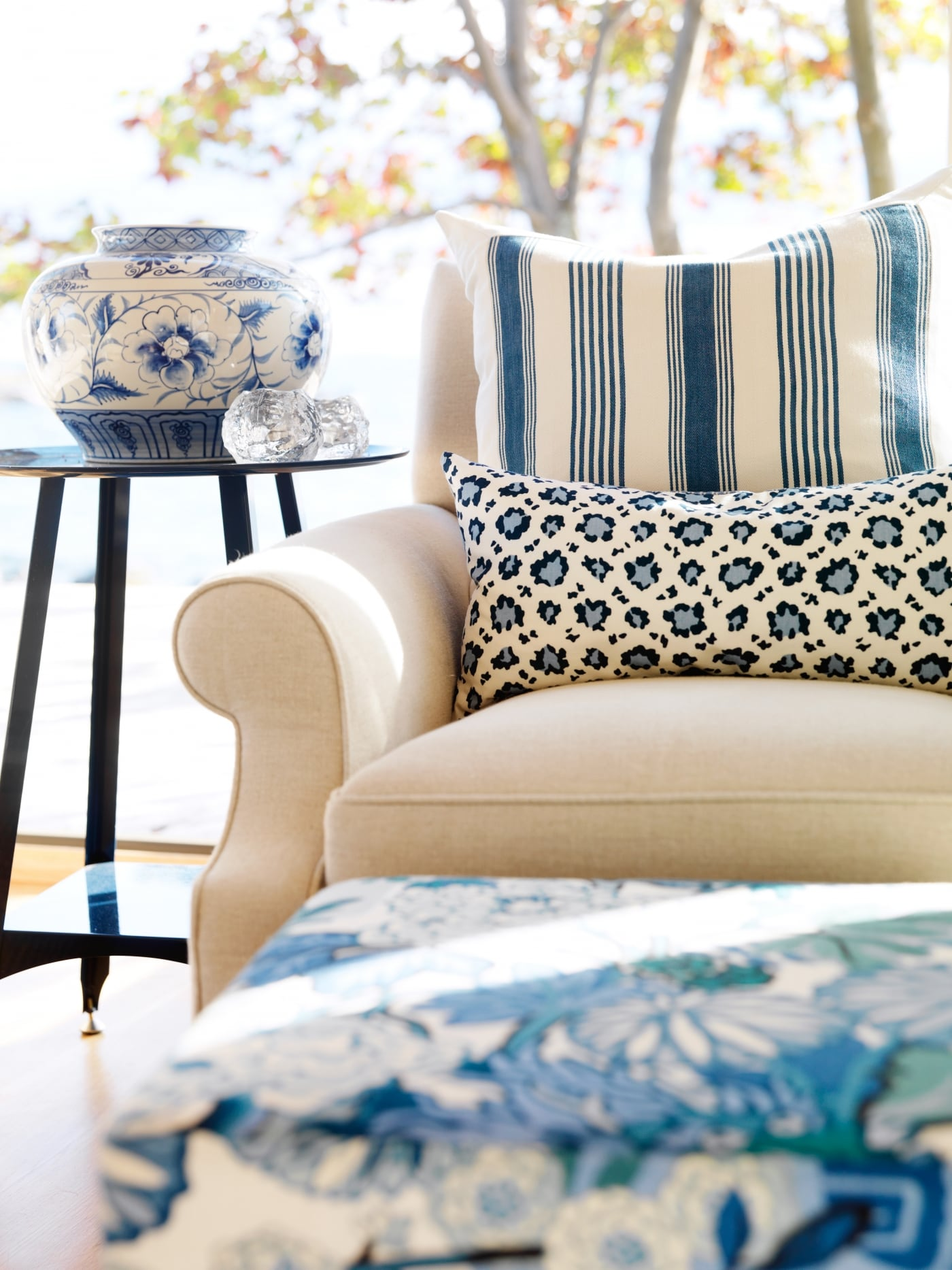 Close up of white chair with blue striped pillow and animal print - Sarah Richardson