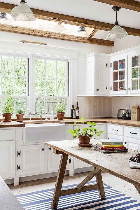 White country kitchen with barn wood accents and apron front farm sink. #SarahRichardson #cottagestyle