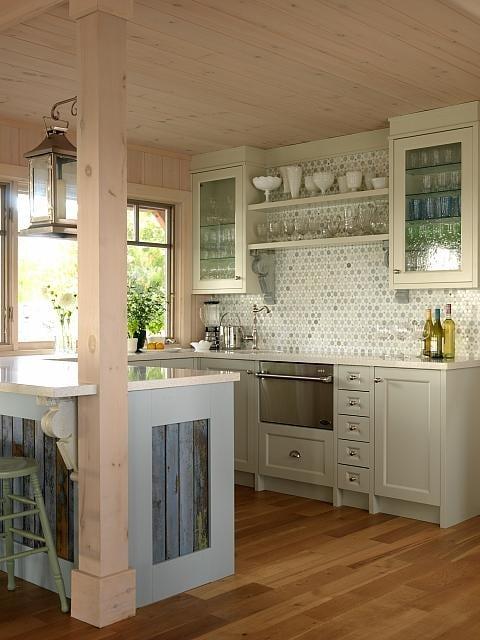 Small cozy #cottagekitchen with mosaic backsplash and wood celing by Sarah Richardson