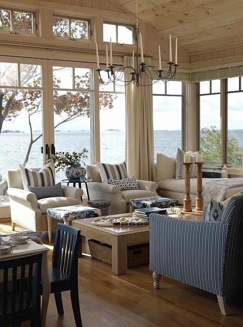 Cottage style lakeside living room with blue and wood ceiling by Sarah Richardson