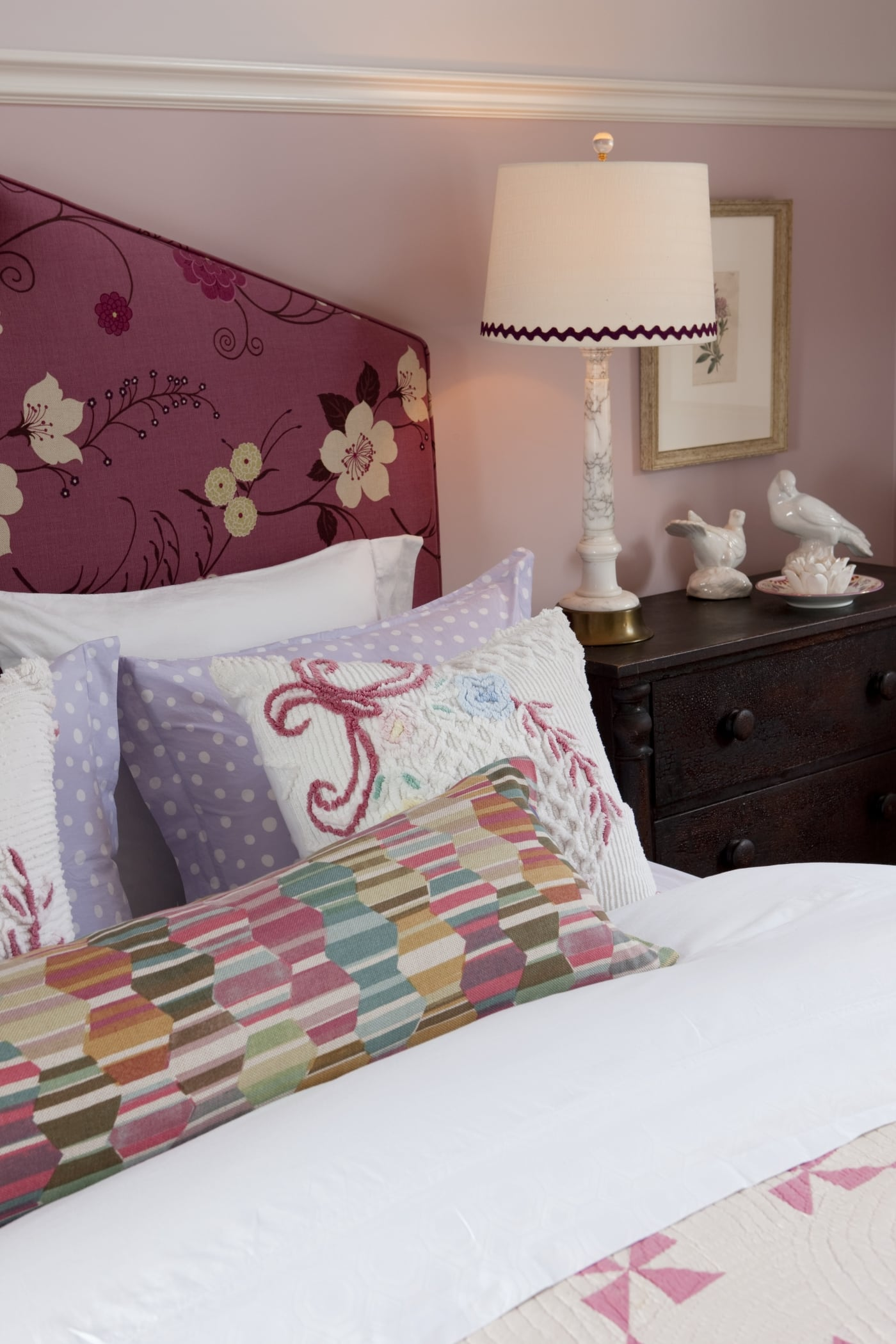 Beautiful deep pink floral upholstered headboard in country bedroom by Sarah Richardson
