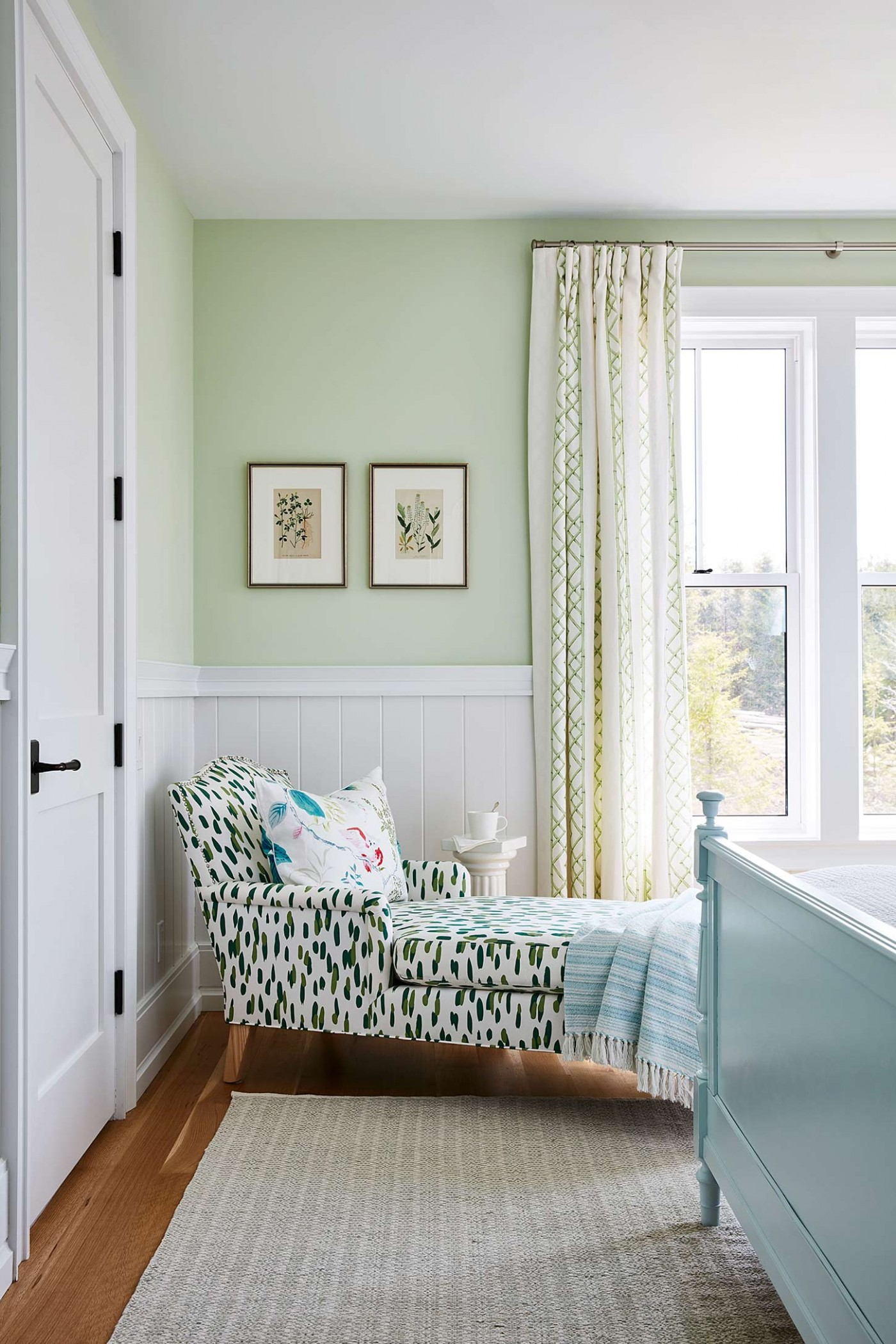 Lounge Chair with whimsical green and blue print in Sarah Richardson designed mint green bedroom