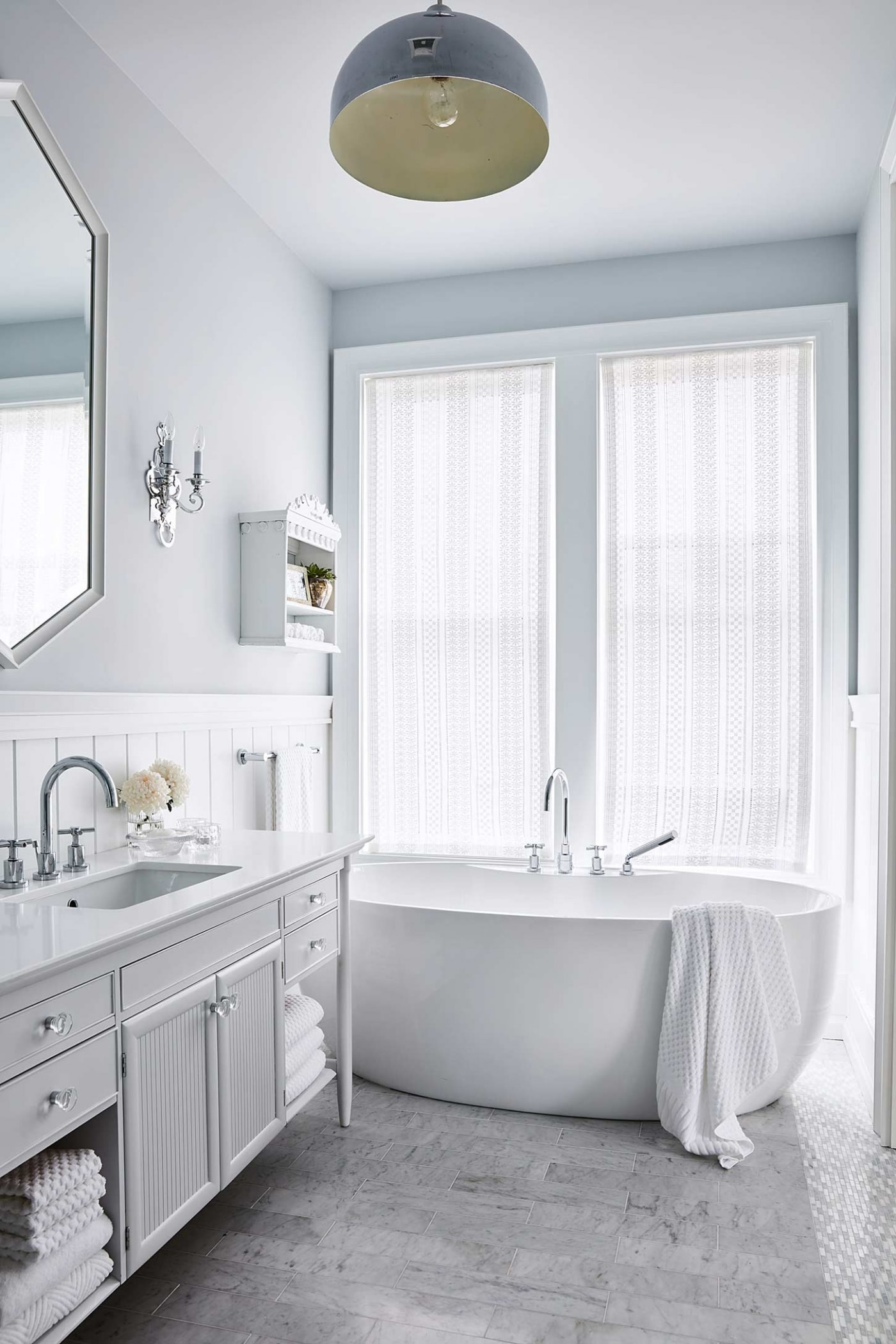 Marble tile in blue bathroom with wide wainscot and vintage style - Sarah Richardson