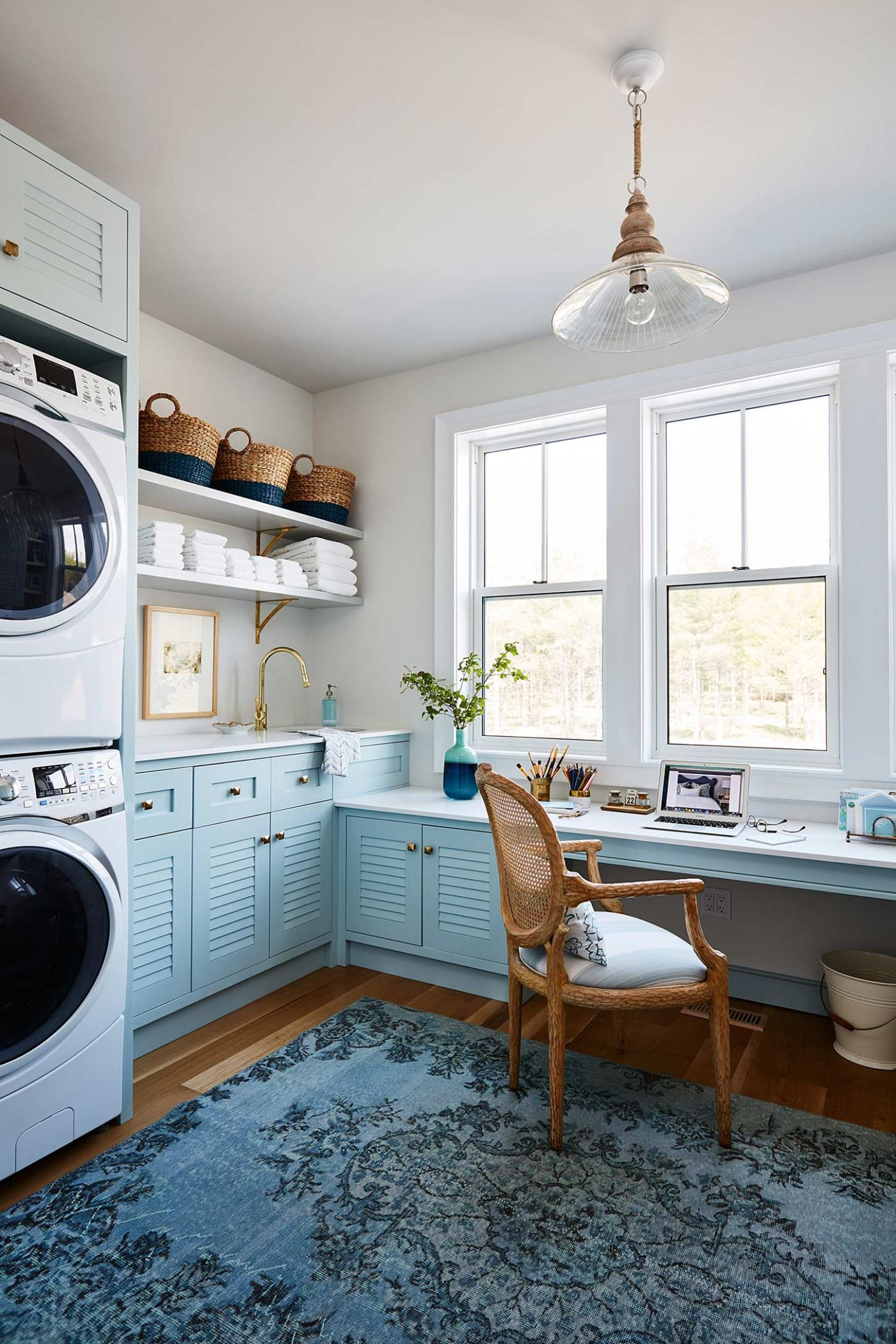 Built in washer and dryer in a baby blue color