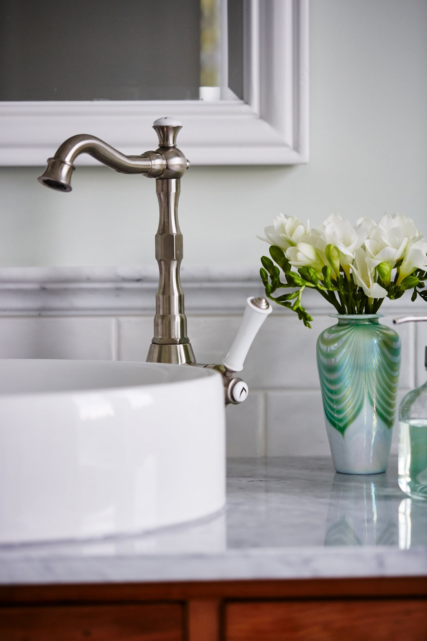 Detail of vessel sink and faucet in marble bathroom designed by Sarah Richardson - Sarah off the Grid