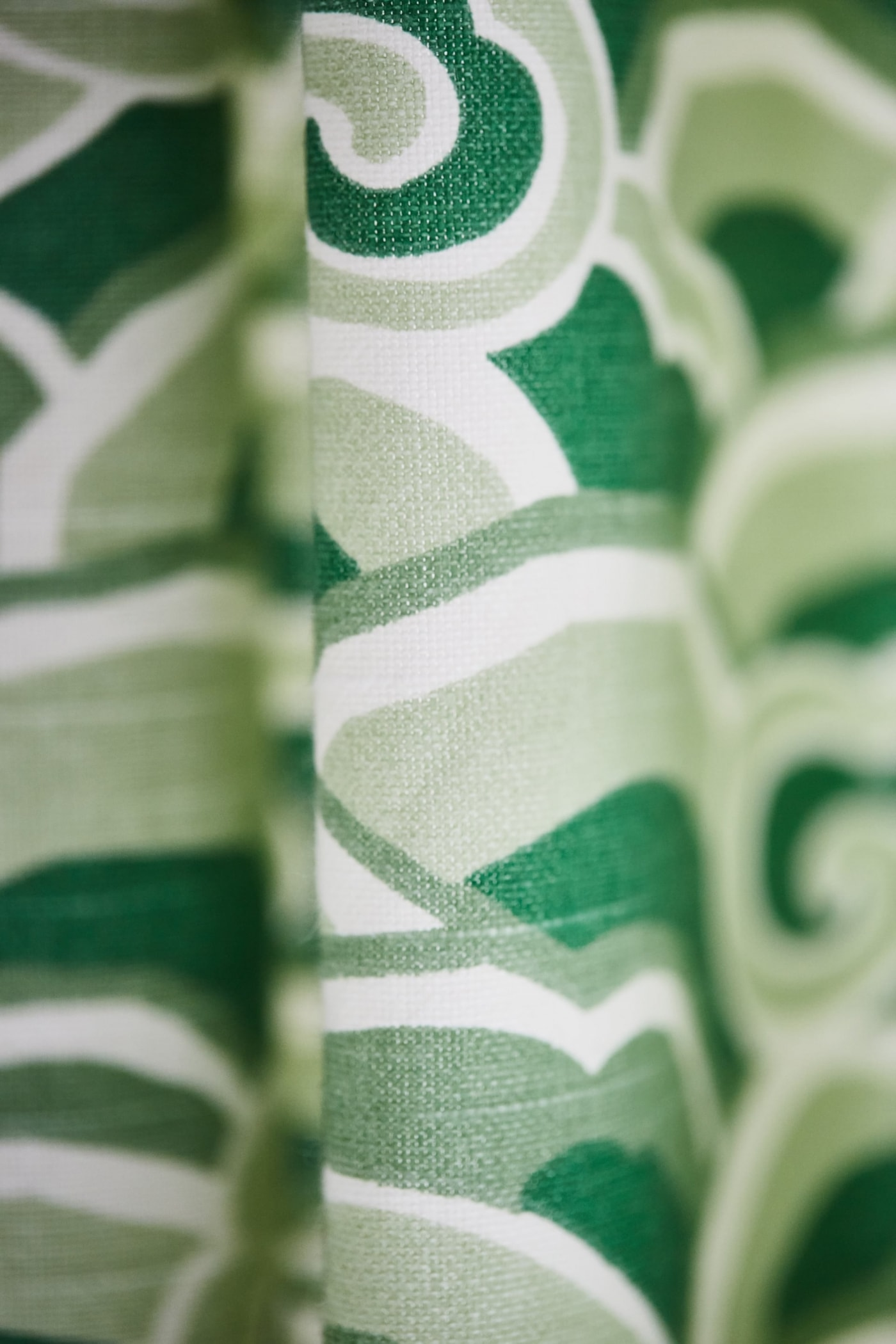Detail of vibrant green print curtains in Sarah Richardson designed bathroom - Sarah off the Grid