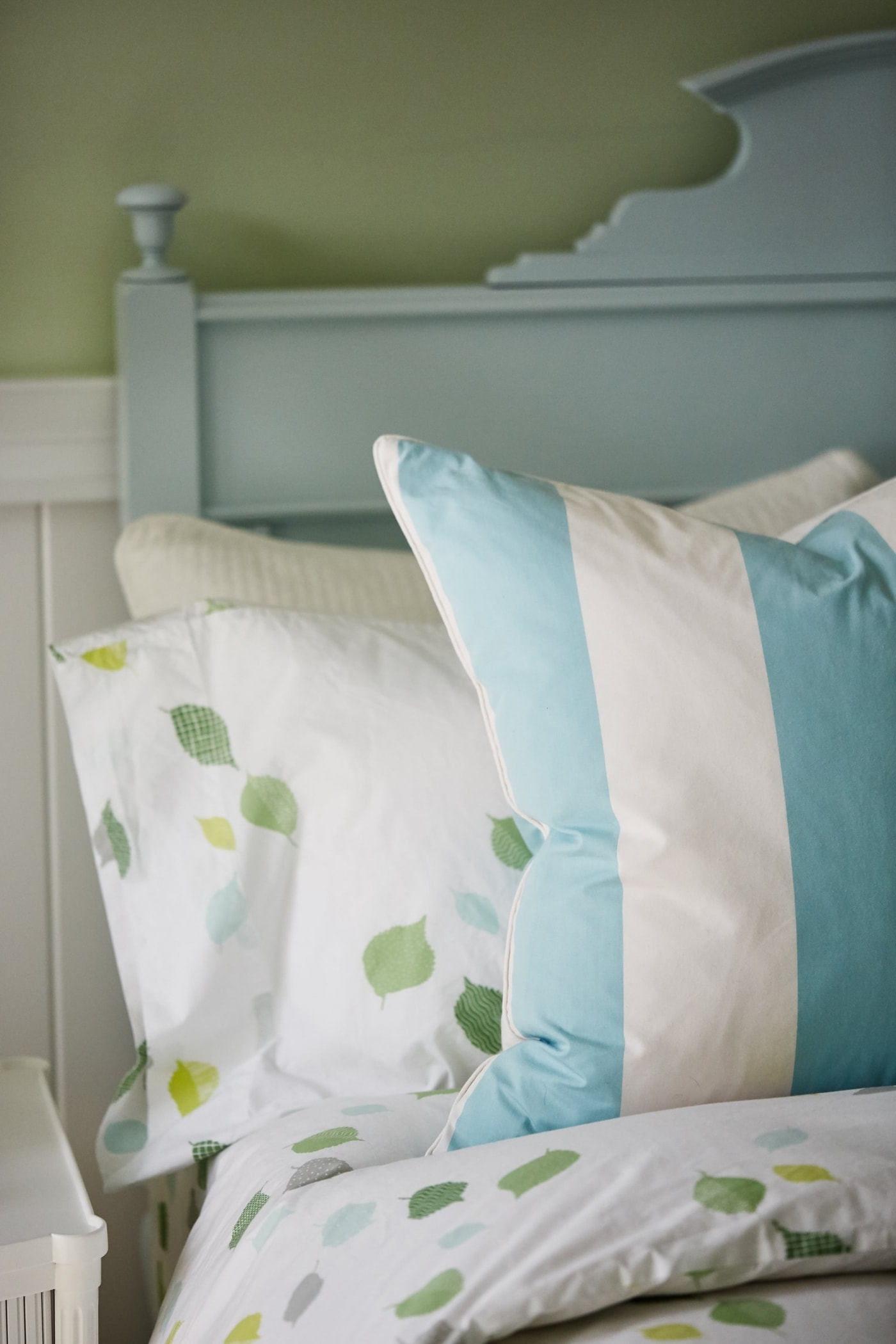 Tiffany blue cottage style bed and striped pillows in Sarah Richardson daughter's room