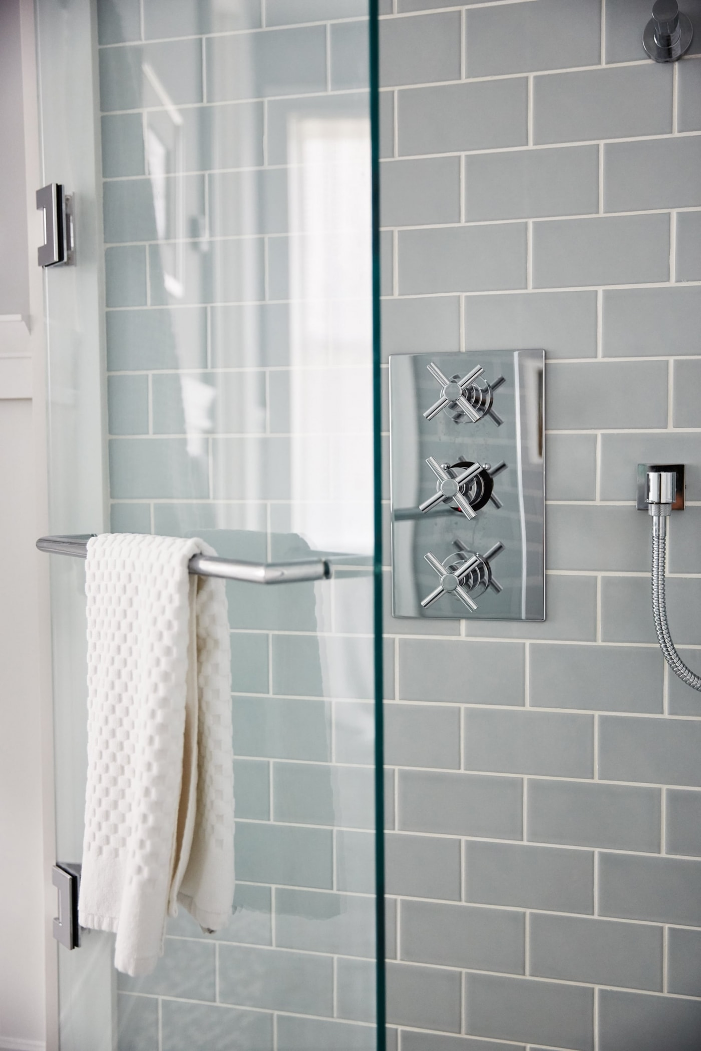 Blue subway tile in luxury shower in Robin's Bathroom - Sarah off the Grid
