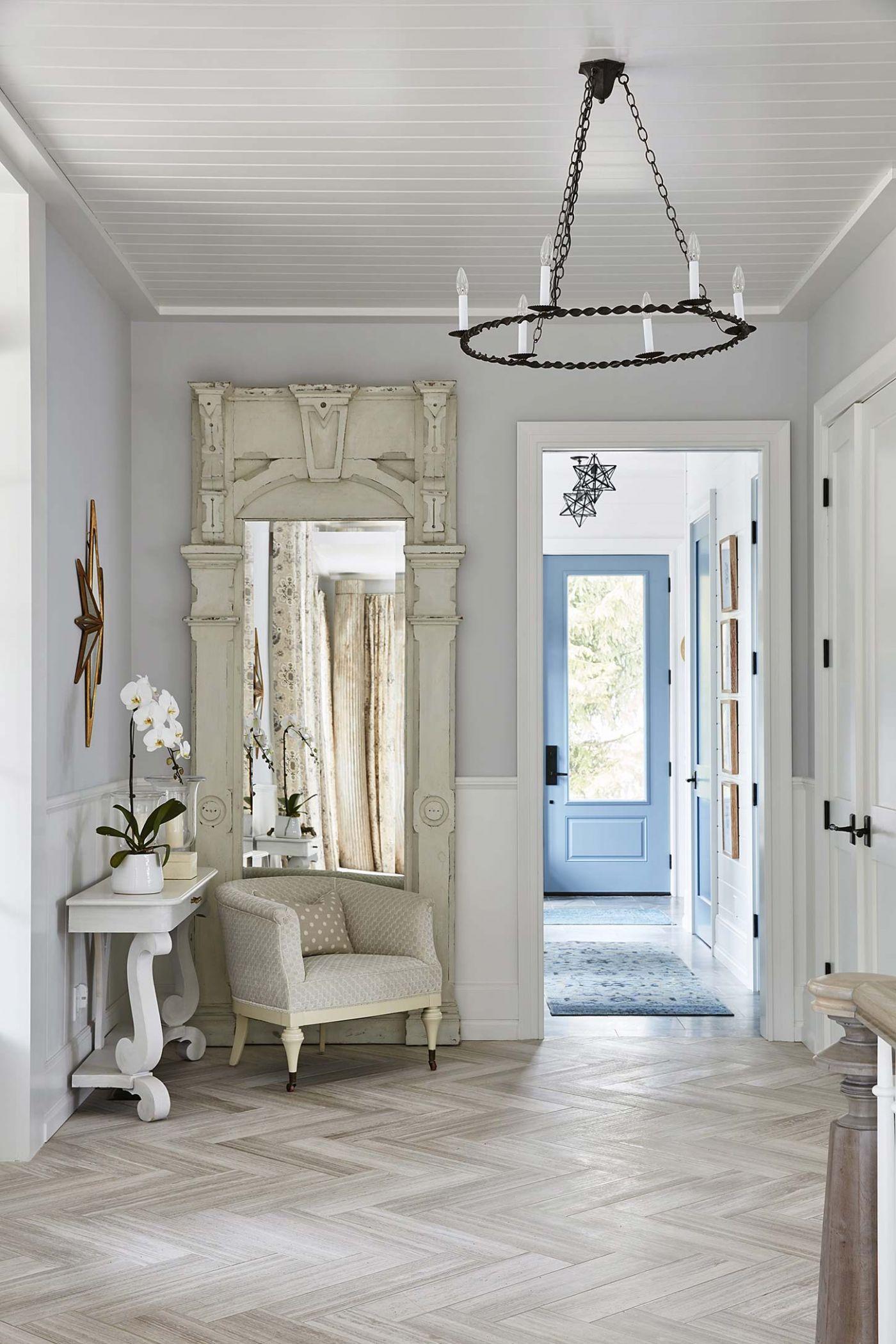 Herringbone floors, scroll console tables, and modern farmhouse decor in Foyer - Sarah off the Grid