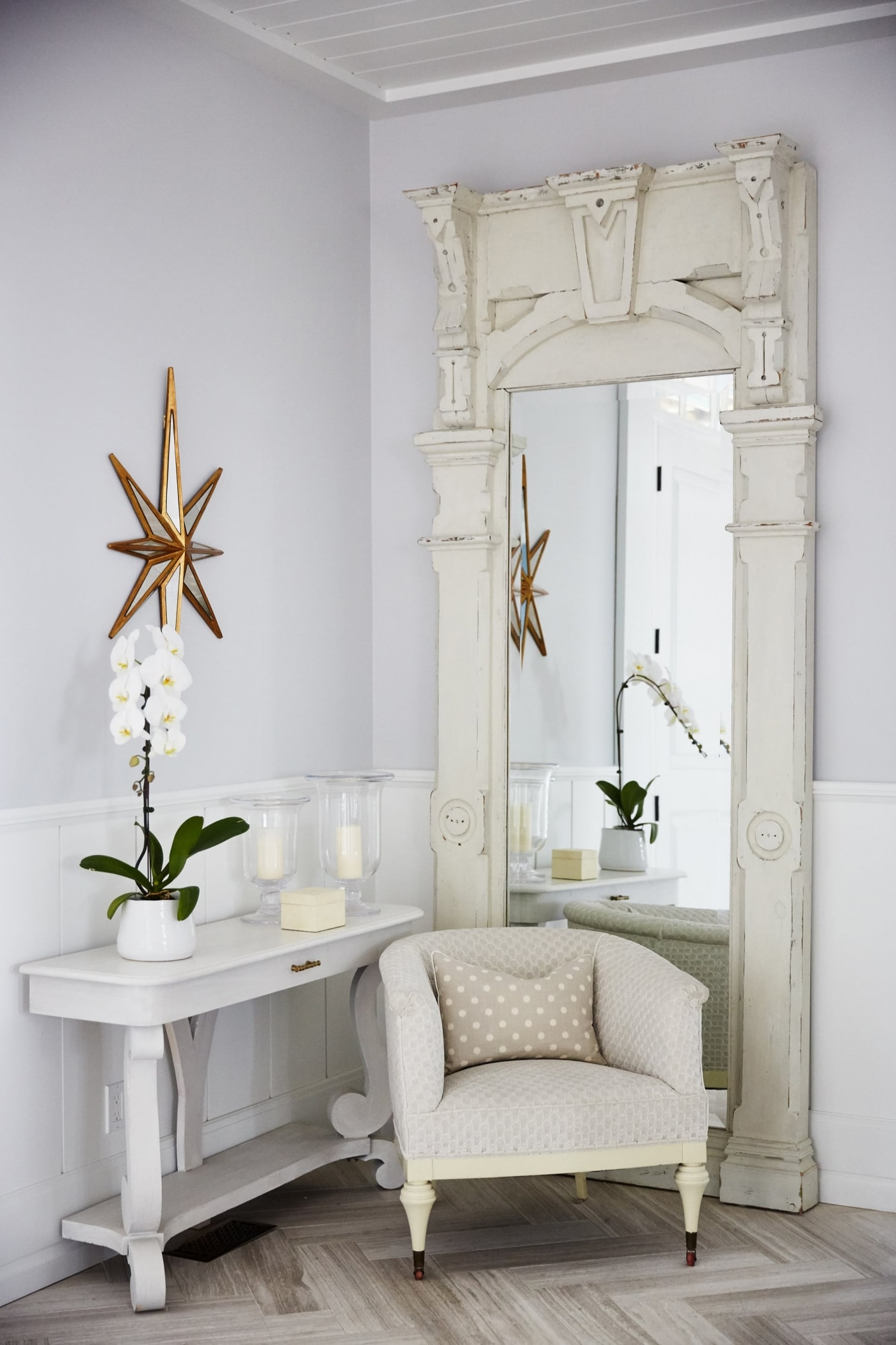 Barrel back upholstered arm chair, vintage mirror, and console table in Foyer - Sarah off the Grid