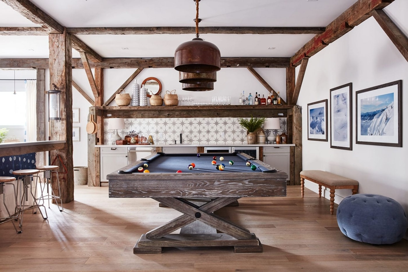 Dark grey wooden pool table with dark blue felting in media room by Sarah Richardson