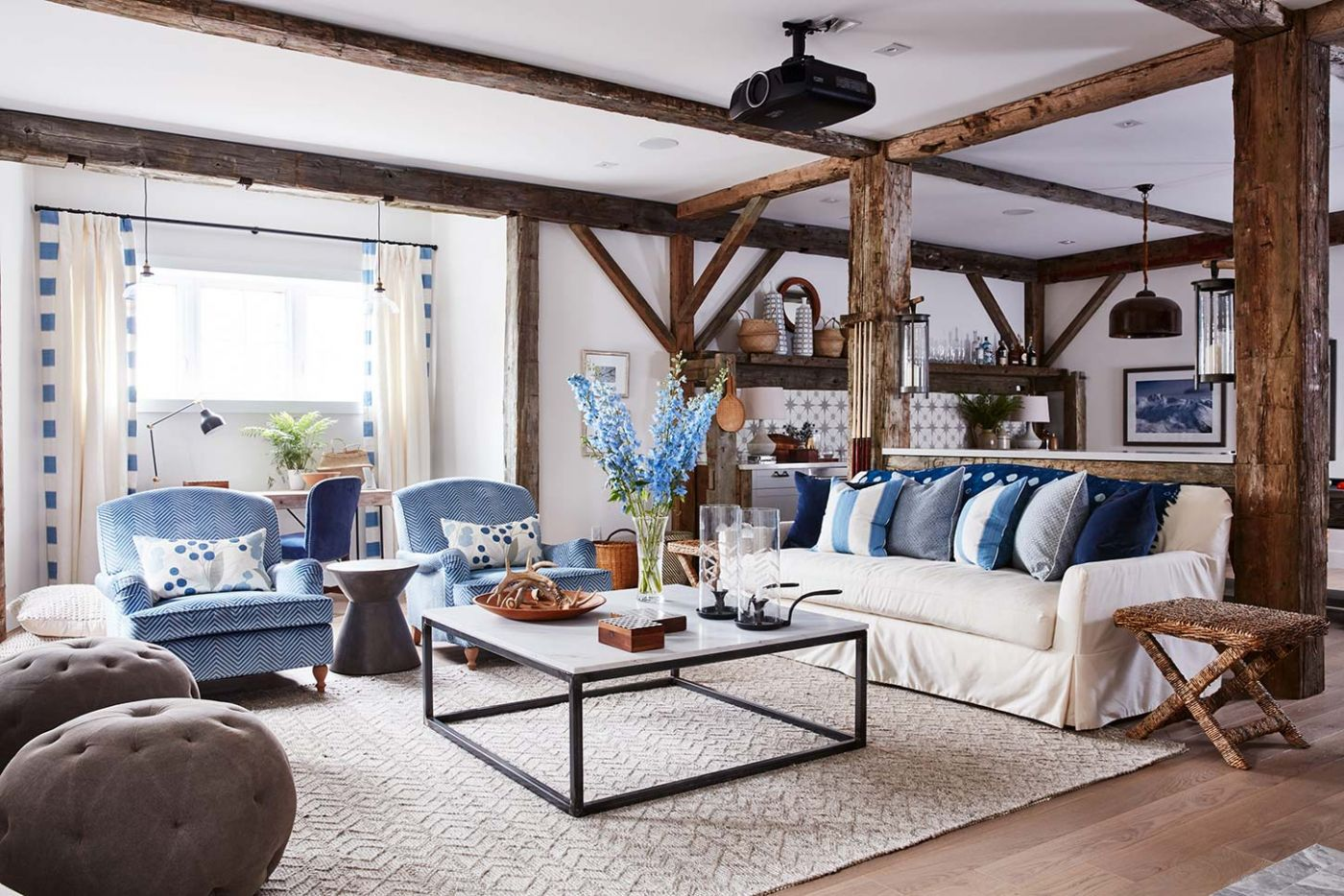 Sarah Richardson's media room in her off the grid farmhouse. White slipcovered sofa and blue accents with rustic decor. Interior Design Ideas: Cottage, Farmhouse & Coastal Style Furniture.