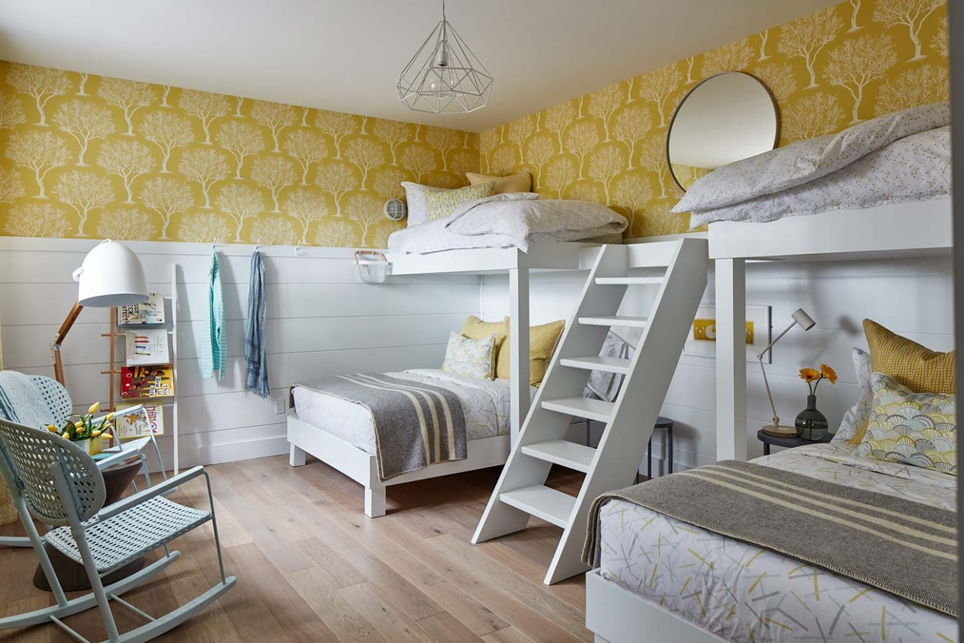 White cottage style bunk room with yellow wall paper - Sarah Richardson's off the grid house