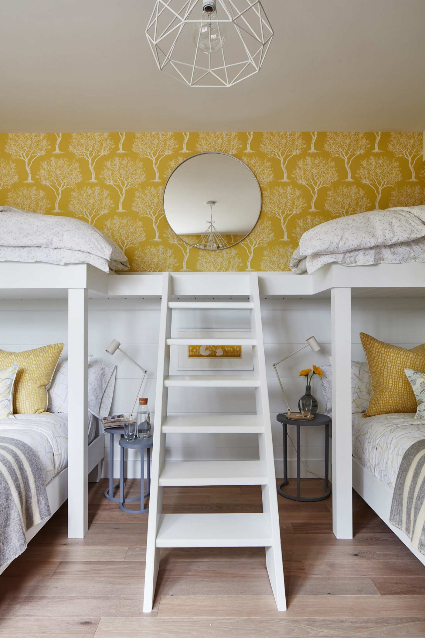 Stairs to bunkbeds in cottage style bunk room by Sarah Richardson