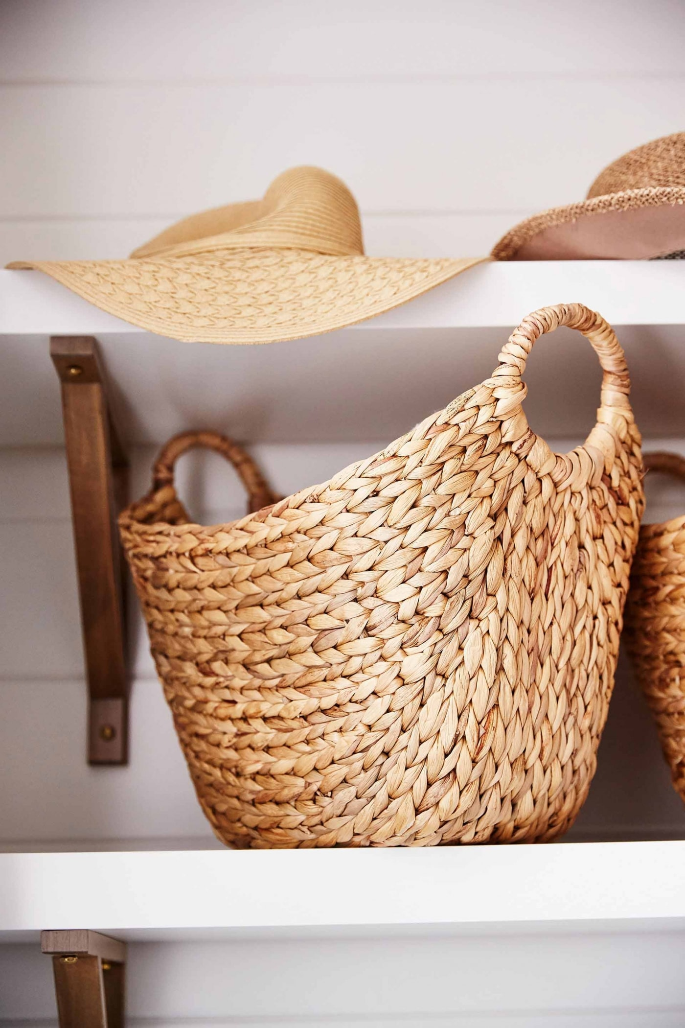 Mudroom - Sarah off the Grid. Seagrass basket on an open shelf. #seagrass #wovenbasket