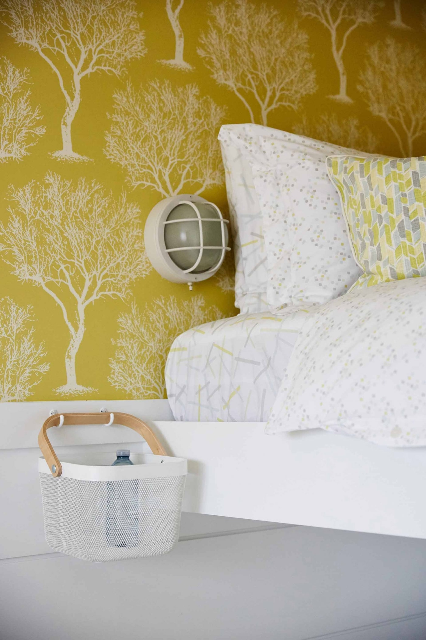 Yellow wallpaper with trees in Bunk Room - Sarah Richardson's off the Grid home